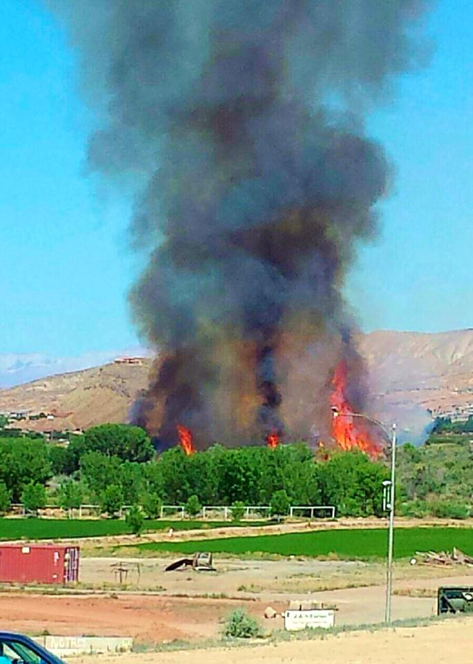 Brush fire near the construction of Mall Bridge and Cox Farm, St. George Utah, June, 1, 2014   Photo by Corbin Wade, St. George News