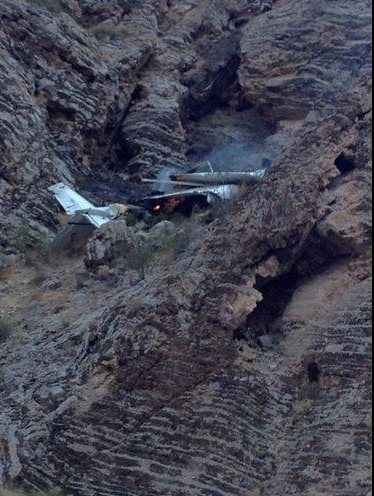 Plane crash upon a ledge in the Virgin River Gorge in the area of Interstate 15 at mile post 13.3 – 4.7 miles north of Littlefield, Arizona, July 20, 2014 | Photo courtesy of Arizona Highway Patrol Sgt. John T. Bottoms, St. George News