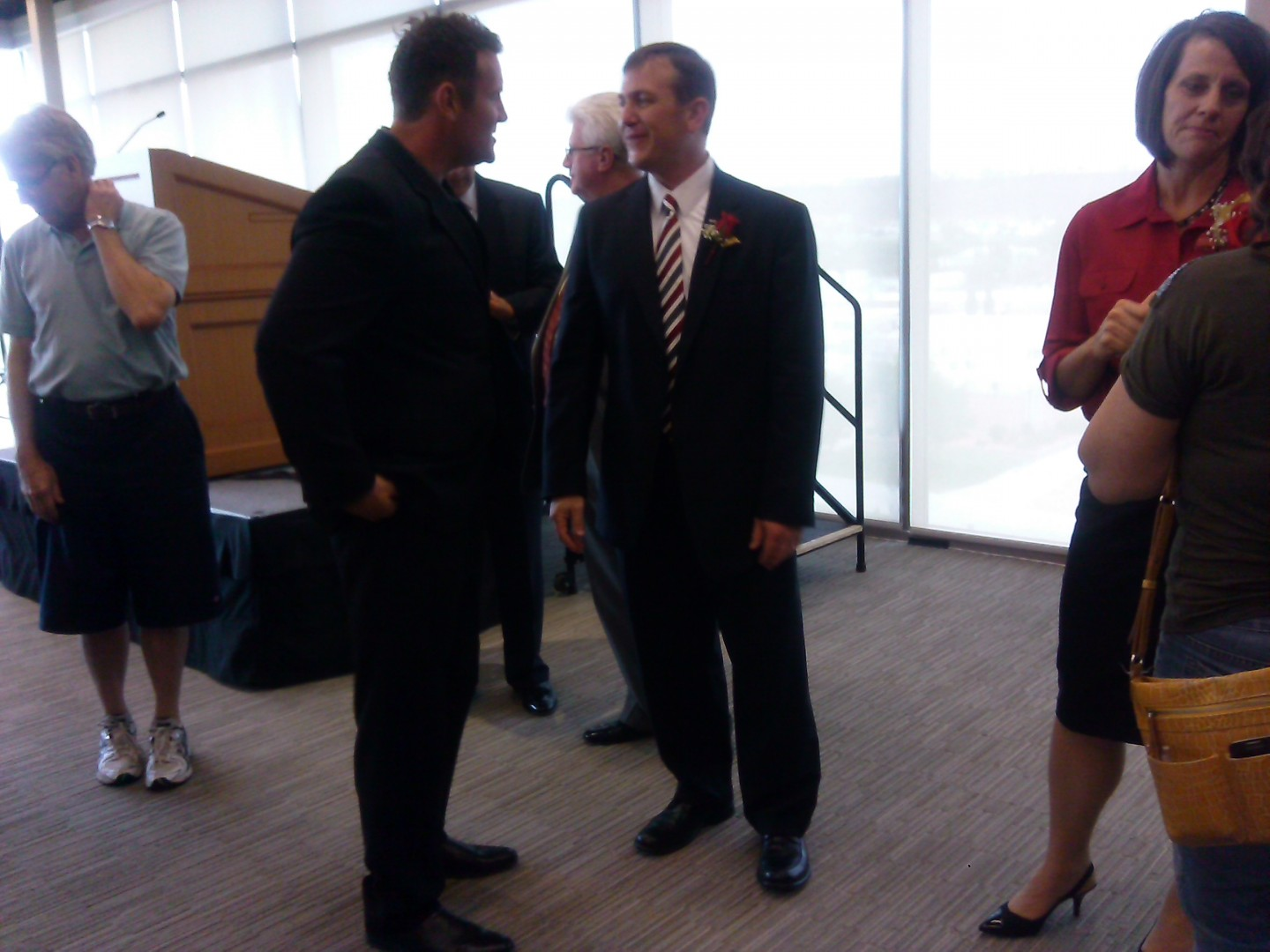 "Dr. Richard ""Biff"" Williams, right, greets people after being named president of Dixie State University. Ceremony held at the Zion Room of the Holland Centennial Commons, DSU, St. George, Utah, July 17, 2014 