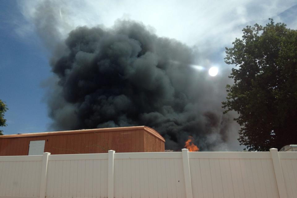 A fire blazes near Dixie High School, St. George, Utah, July 19, 2014 | Photo courtesy of Melinda Charlet, St. George News