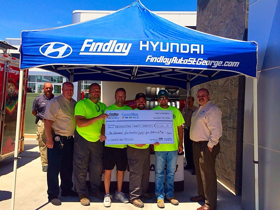 Findlay Automotive of Utah presented Washington County Sheriff Cory Pulsipher with a $10,500 check for Search and Rescue at Findlay Subaru, St. George, Utah, July 31, 2014 | Photo by Kimberly Scott, St. George News