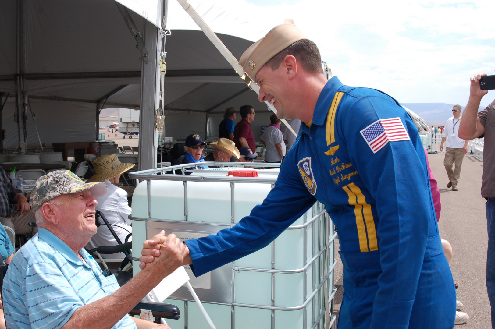 Lt. Cmdr. Mark DeBuse greets veterans from the Southern Utah Veterans Home at a special audience with the Blue Angels, St. George, Utah, July 25, 2014 | Photo by Hollie Reina, St. George News