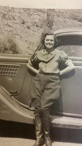 Cornelia Ashby Nisson stands in front of a truck at a young age, date and location unknown | Photo courtesy of Michelle Ashby Fleming, St. George News