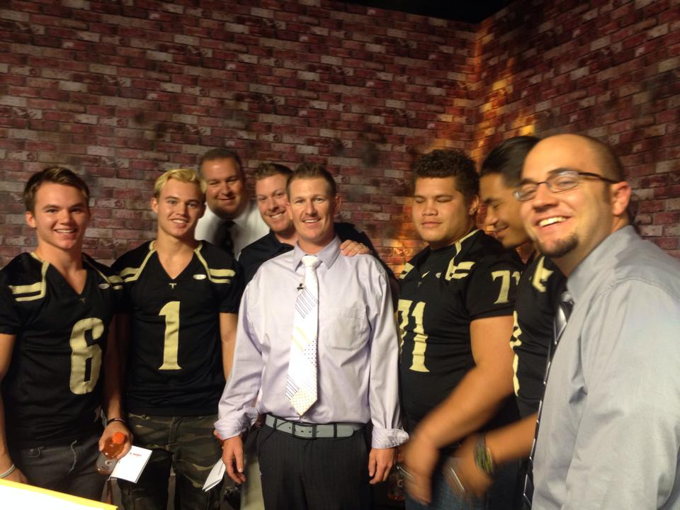 Desert Hills players pose with media members during the 2014 3AA South Media Day.