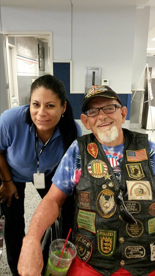 Raymond M. Black poses with a flight attendant before his departure from Groesbeck, Texas, July 27, 2014 | Photo courtesy of Raymond M. Black, St. George News