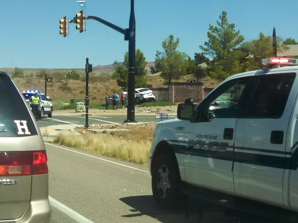 Single-car accident at the intersection of 2260 State Street and Arlington Parkway. The driver allegedly fell asleep and ran the car into a stone wall, Hurricane, Utah, Aug. 8, 2014 | Photo courtesy of Christine DeMille, St. George News