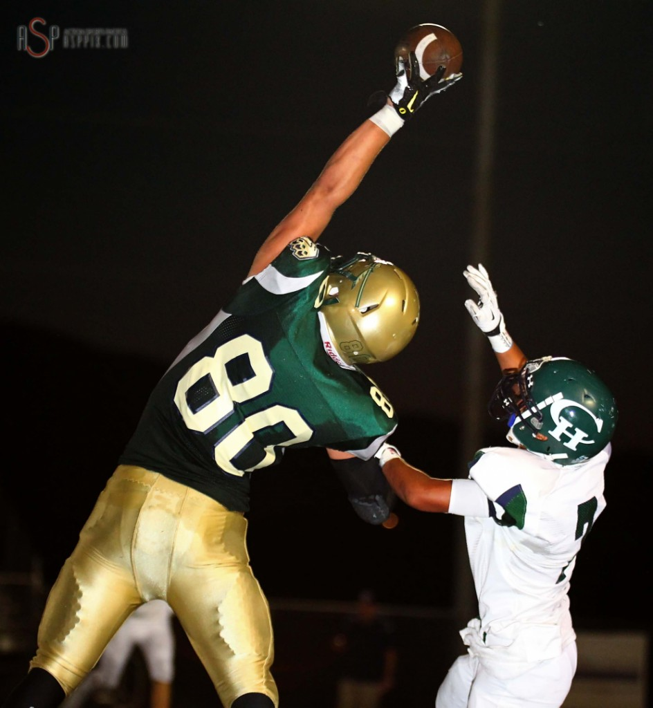 Chance Thorkelson reaches high to catch a pass, Snow Canyon vs Copper Hills, St. George, Utah, August 22, 2014 | Photo by Robert Hoppie, ASPpix.com, St. George News