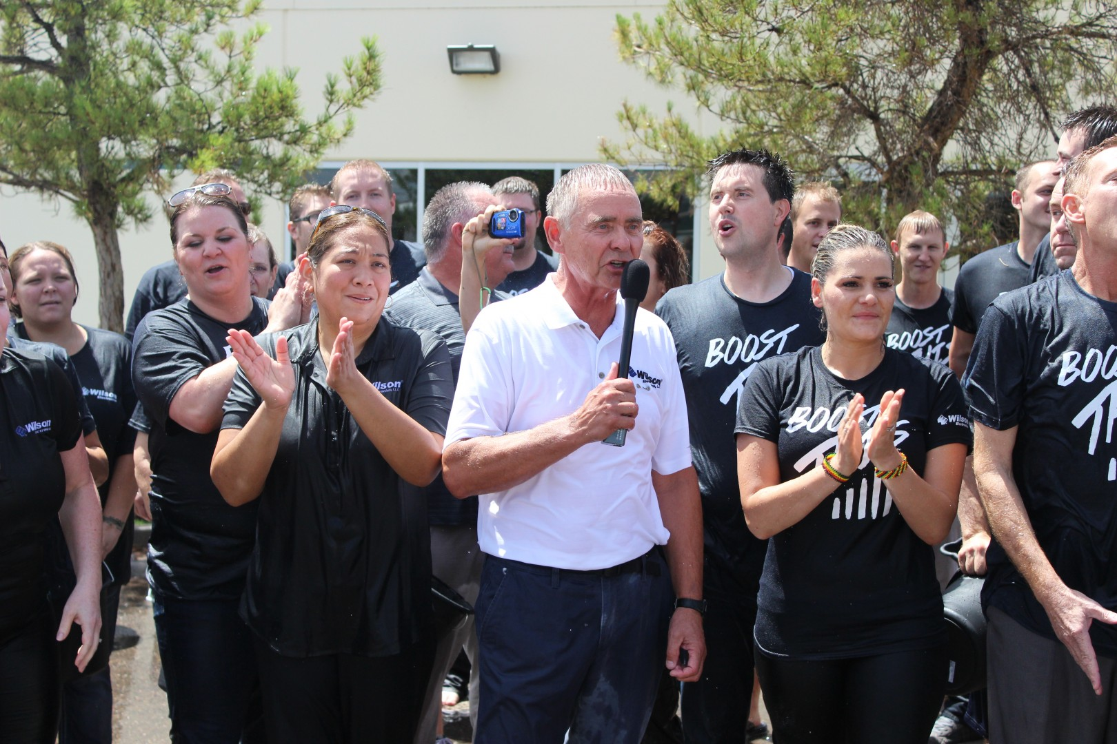 Don Blohm, COO of Wilson Electronics, gives a speech after completing the ASL Ice Bucket Challenge in St. George on Aug. 21, 2014 | Photo by Devan Chavez, St. George News