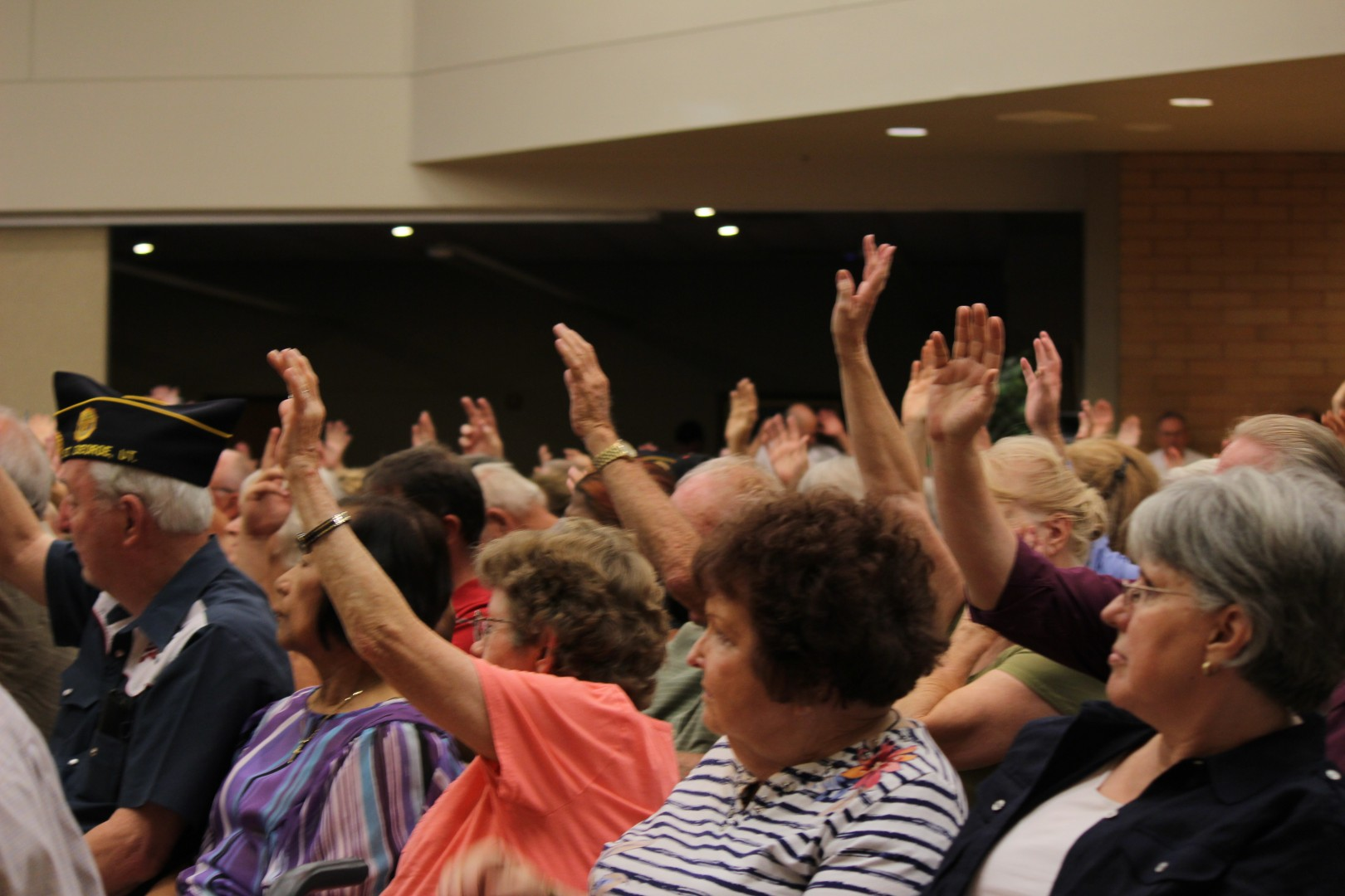 Members of the audience raise their hands during Mike Lee's town hall meeting at Dixie Statue University in St. George on Aug. 29, 2014 | Photo by Devan Chavez, St. George News.