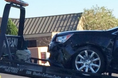 Buick Lacrosse involved in a two-car collision at the intersection of River Road and Riverside Drive, St. George, Utah, Aug. 31, 2014 | Photo by Devan Chavez, St. George News