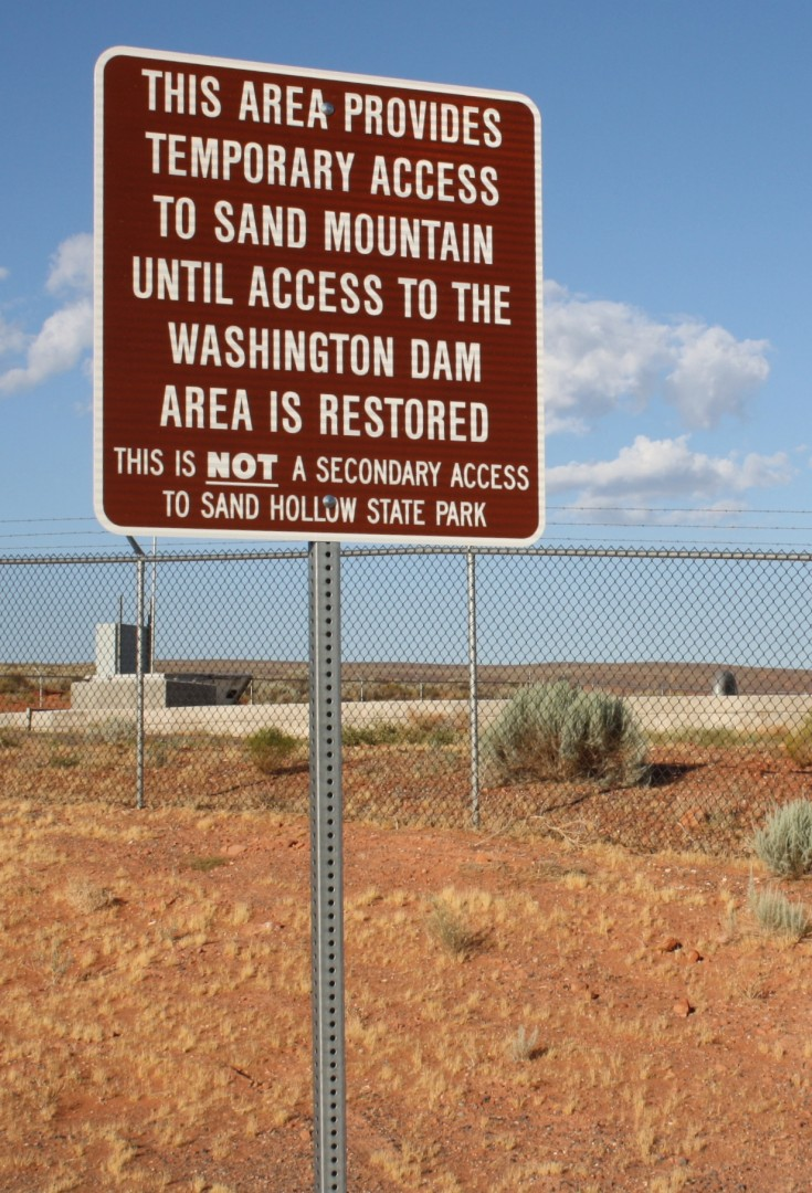 A sign by the water tanks above the intersection of Sand Hollow Road and the Southern Parkway, explaining it is only a temporary access point to the Sand Mountain OHV trails, July 11, 2014 | Photo by Reuben Wadsworth, St. George News