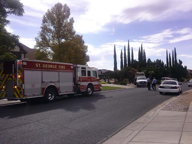 Wrecker drags car out of the front yard of a home near 346 N. Donlee Dr. in St. George, Utah, Aug. 10, 2014 | Photo by Aspen Stoddard, St. George News