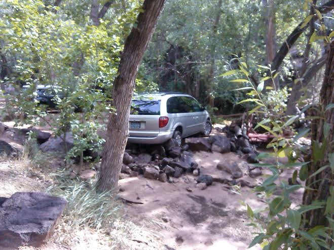 Gorgonio Diaz's van wedged on rocks after having slid 40 feet down the Santa Clara River during the flash flood in Crawdad Canyon at Veyo Pools, Veyo, Utah, Aug. 2, 2014 | Photo by Aspen Stoddard, St. George News