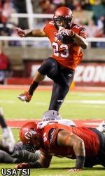 Utah Utes running back Devontae Booker (23) hurdles Washington State Cougars linebacker Kache Palacio (40) during the second quarter at Rice-Eccles Stadium, Sep 27, 2014; Salt Lake City, UT; Chris Nicoll-USA TODAY Sports