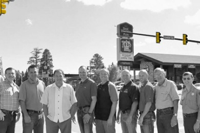 Utah Governor Gary Herbert stands with Bryce Canyon City leaders on the newly completed Bryce Canyon City Main Street and the first stoplight in Garfield County. L to R: Lance Syrett, Commissioner Leland Pollock, Mayor David Tebbs, Herbert, Mike Stevens, Gary Syrett, Bryce Syrett, Shiloh Syrett, Jean Seiler, Superintendent Jeff Bradybaugh, and Nick Pollock, Bryce Canyon City, Utah, Aug. 15, 2014 | Photo courtesy of Bryce Canyon City, for St. George News