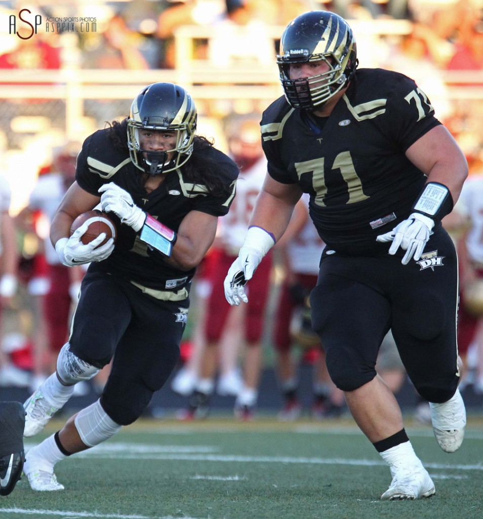 Gabe Sewell runs behind the blocking of his cousin, Boogie Sewell (71), Cedar at Desert Hills, St. George, Utah, September 12, 2014 | Photo by Robert Hoppie, ASPpix.com, St. George News