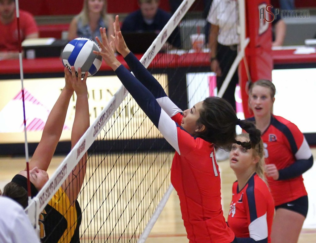 Edithza Urias blocks a Dominican players volley, Dixie State University vs. Dominican University, St. George, Utah, September 20, 2014 | Photo by Robert Hoppie, ASPpix.com, St. George News