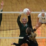 Snow Canyon defenders Shaylee Reed (left) and Jordan Gines (right) look to block Tiera Orr's spike,  Snow Canyon vs Desert Hills Volleyball, St. George, Utah, September 23, 2014 | Photo by Robert Hoppie, ASPpix.com, St. George News
