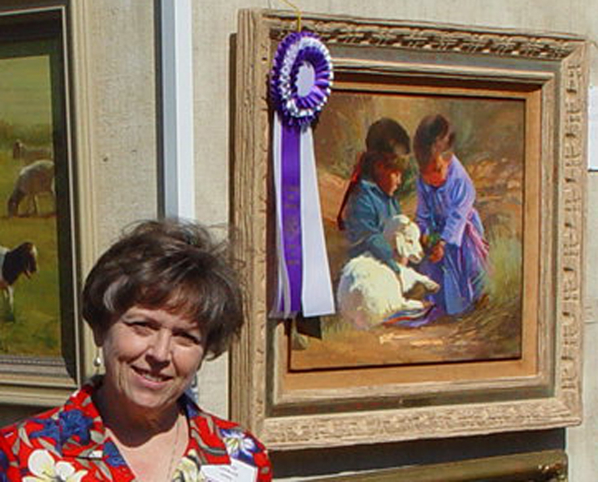 Bonnie Conrad with one of her art works, date/location not provided | Photo courtesy of St. George Art Museum, St. George News