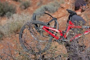 A bike belonging to rider Kelly McGarry of New Zealand gets mangled after a missed backflip on a 72-foot canyon gap at Red Bull Rampage, Virgin, Utah, Sept. 29, 2014 | All licensed images are printed with the express permission of Red Bull Media House North America Inc., Photo by Hollie Reina, St. George News