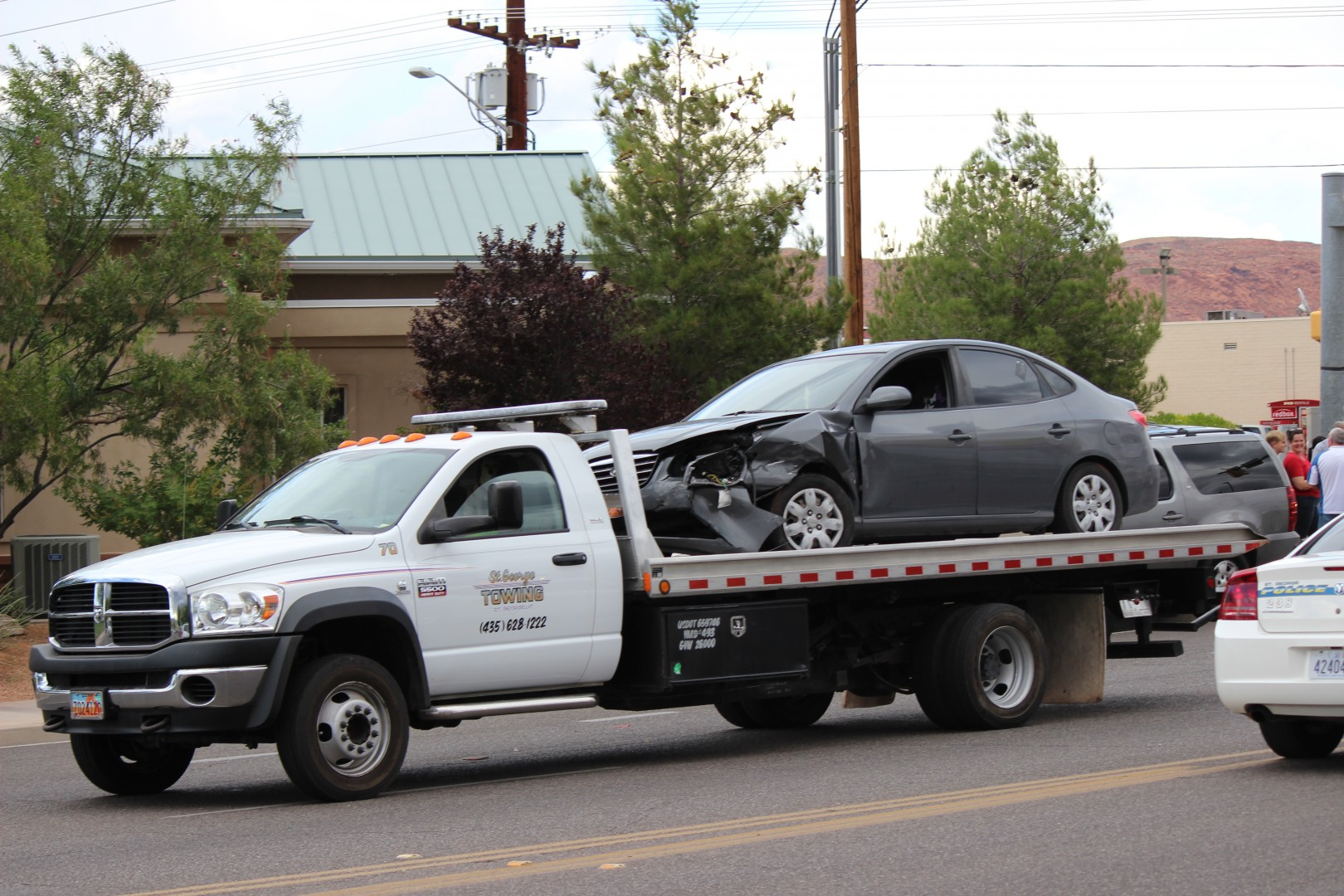 The Hyundai involved in the collision is towed away from the scene of wreck at the intersection of Sunset Blvd. and Dixie Drive on Sept. 4, 2014 | Photo by Devan Chavez, St. George News.