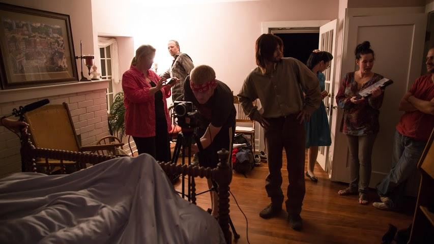 """Members of the production crew for """"A Tale Told Heart"""" work away in the Covington Mansion on Sept. 20, 2014 