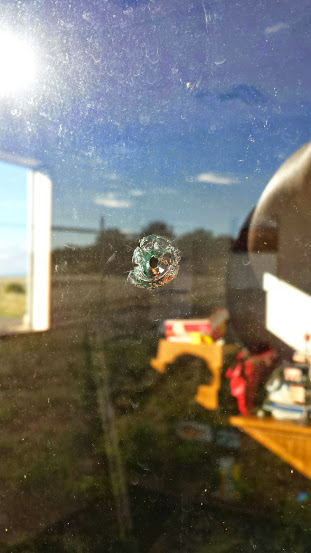 A bullet hole shot through the window of a Mohave County victims advocate, Colorado City, Arizona, Sept. 4, 2014   Photo courtesy of Kim Nuttall, St. George News