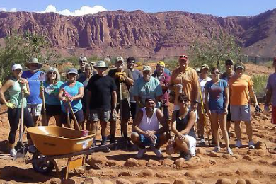 Volunteers break from working and stand together at the Desert Rose Labyrinth Sculpture Garden in Kayenta, Ivins, Utah, Sept. 19, 2014 | Photo by Aspen Stoddard, St. George News