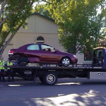 A red Kia gets towed after the accident that occurred at the intersection of 200 East and 300 South in St. Geroge, Utah, Sept. 14, 2014 | Photo by Aspen Stoddard, St. George News