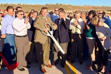 Mayor Jon Pike cuts the ribbon for the new Mall Drive Bridge, St. George, Utah, Sept. 30, 2014 | Photo by Kimberly Scott, St. George News