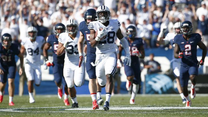 Former Snow Canyon star Adam Hine takes it to the house Saturday | Photo courtesy BYU Athletics
