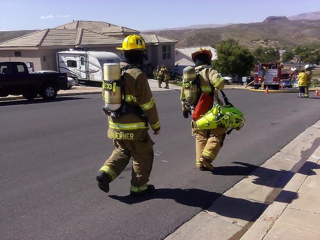 Firefighters work to extinguish a fire at 1434 N. Santa Clara Dr. in Santa Clara, Utah, Sept. 17, 2014 | Photo by Aspen Stoddard, St. George News