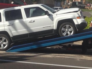 A Jeep Patriot is towed from an accident scene after it hit into a Honda Civic that ran a red-light, St. George, Utah, Oct. 23, 2014 |Photo by Holly Coombs, St. George News