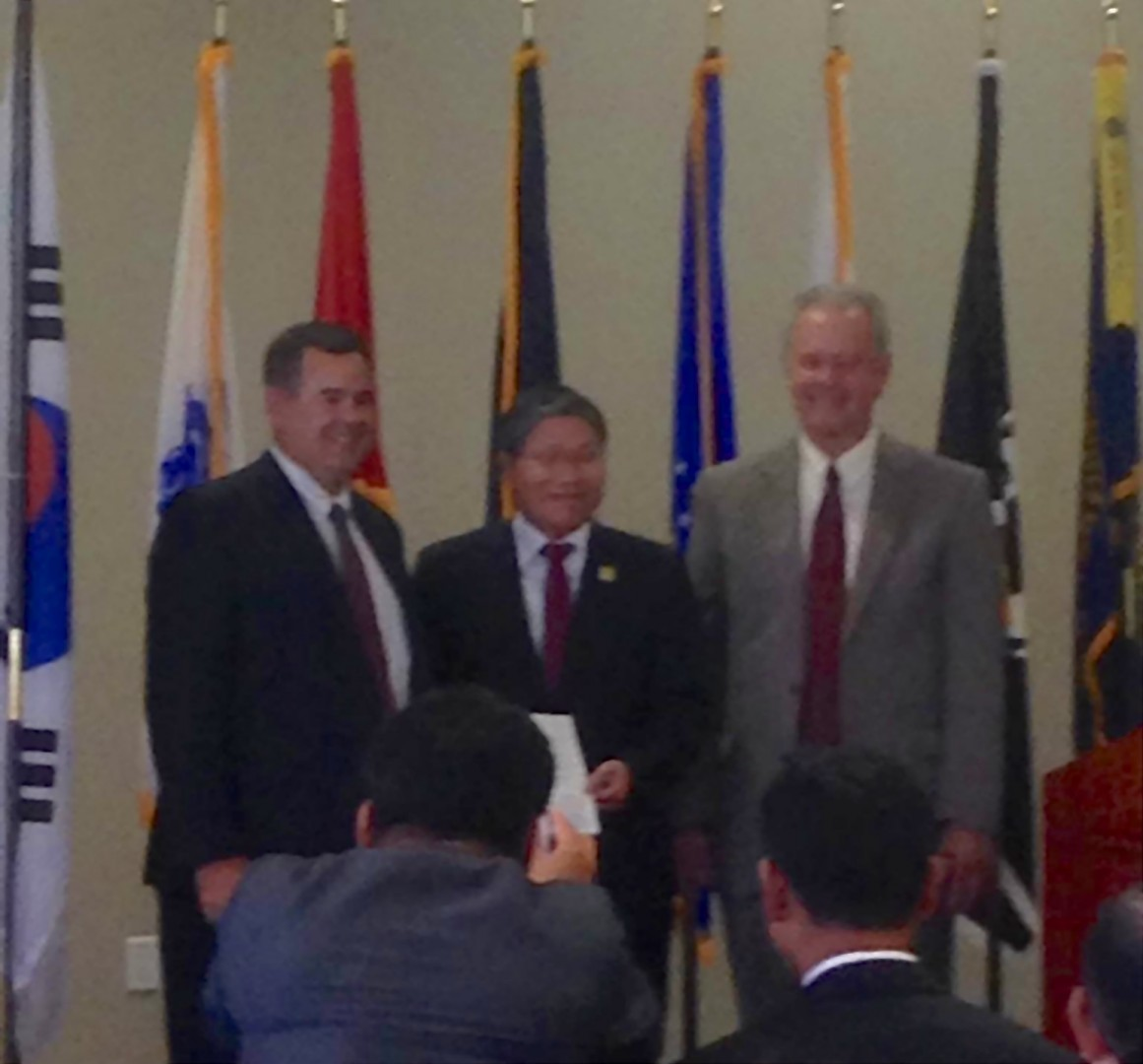 L-R: City of St. George Mayor Jon Pike, Republic of Korea Consul General Dongman Han and Ivins City Mayor Chris Hart display a proclamation recognizing Korean Veteran Day, Ivins, Utah, Oct. 17, 2014 | Photo by Holly Coombs, St. George News