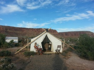 """Tami Thomas enjoys the view from the front of the less expensive, ground level, """"safari"""" tent at Moab's """"glamping"""" resort, Moab Under Canvas, Moab, Utah, Sept. 16, 2014 