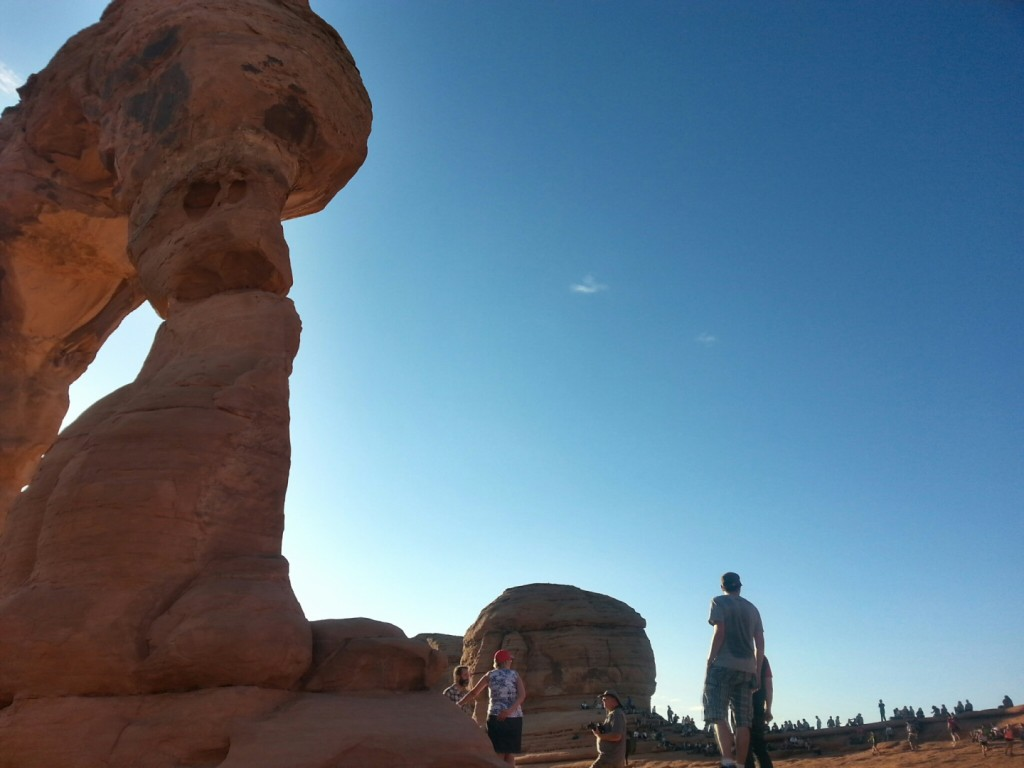 A crowd waits for the sunset near the end of the Delicate Arch Trail, Arches National Park, Utah, Sept. 14, 2014   Photo by Drew Allred, St. George News