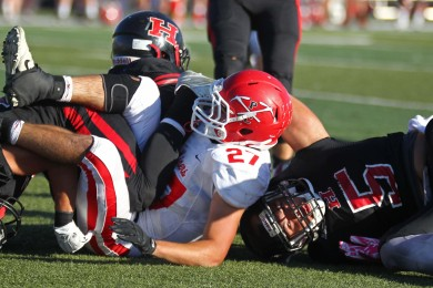 Tiger defenders pile up the Park City ball carrier, Hurricane vs. Park City,  Hurricane, Utah, Oct. 31, 2014 | Photo by Robert Hoppie, ASPpix.com, St. George News