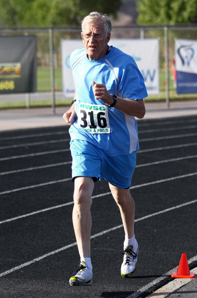 Dale Perkins rounds the corner during the 1500-meter race at the Huntsman Senior Games Track and Field event, St. George, Utah, Oct. 8, 2014   Photo by Robert Hoppie, ASPpix.com, St. George News