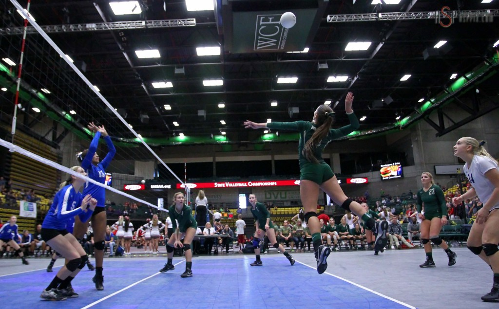 """Snow Canyon hitter Alexsa """"Crash"""" Parker leaps for a shot against Dixie in the semi-finals, 2014 3A State Volleyball Tournament, Orem, Utah, Oct. 30, 2014 