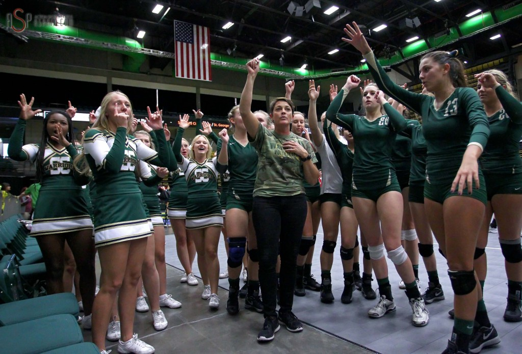 Snow Canyon , wirth coach Alain Parker in the middle, celebrates a semifinal victory over Dixie, 2014 3A State Volleyball Tournament, Orem, Utah, Oct. 30, 2014 | Photo by Robert Hoppie, ASPpix.com, St. George News