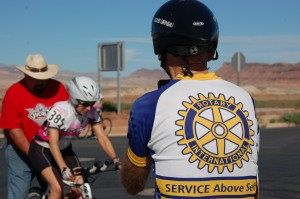 Walt Schafer photographs his wife, Teresa Kludt before she takes off from the start line of the time trials portion of the cycling competition in the Huntsman World Senior Games, St. George, Utah, Oct. 8, 2014 | Photo by Hollie Reina, St. George News