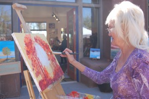 Artist Mary Manning creates a fall inspired work of art at the Art in Kayenta Festival, Ivins, Utah, Oct. 10, 2014 | Photo by Hollie Reina, St. George News