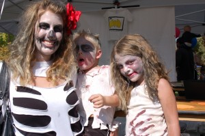 L-R Amber, Tyler and Haylee Ford participate in a craft activity at Spooky Town Fair, St. George, Utah, Oct. 25, 2014 | Photo by Hollie Reina, St. George News