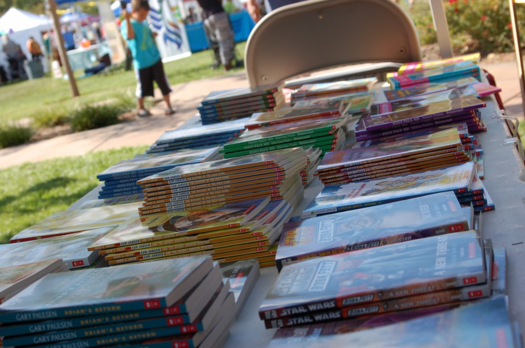 Books are sold at $1 a piece at Spooky Town Fair to help raise funds for the teacher grant program and to encourage reading, St. George, Utah, Saturday, Oct. 25, 2014 | Photo by Hollie Reina, St. George News