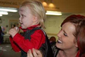 """Ronan Krulisky and Heather Krulisky have fun playing games at the """"Spooktacular"""" fundraiser held at Red Cliffs Health and Rehab, St. George, Utah, Oct. 29, 2014 
