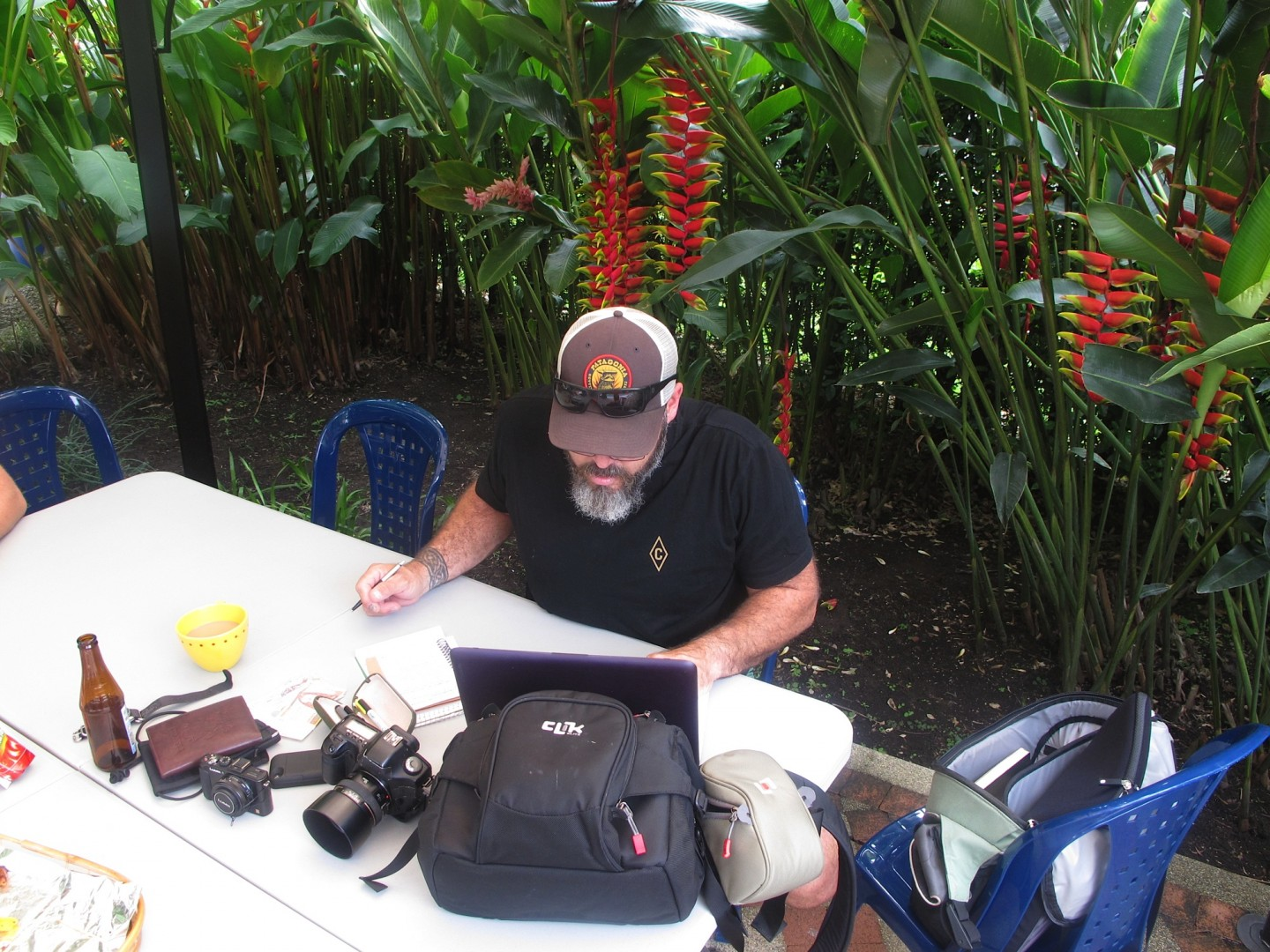 Working photojournalist in the field. Dallas Hyland takes a break from the operation on the patio of an undisclosed villa in Armenia, Colombia to begin documenting, Oct. 2014 | Photo courtesy of Dallas Hyland, St. George News