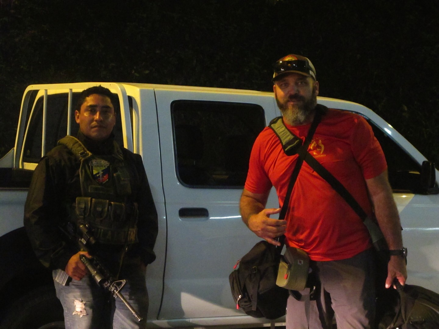 Photojournalist Dallas Hyland with unnamed armed Colombian government escort. The entire team was escorted to the airport for their protection after the busts went down, Oct. 2014 | Photo courtesy of Dallas Hyland, St. George News