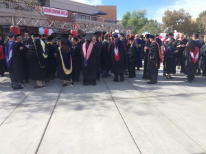 """Students and staff congregating before the inauguration ceremony for university President Dr. Richard """"Biff"""" Williams, M. Anthony Burns Arena, Dixie State University, St. George, Utah, Oct. 23, 2014 