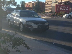 A Toyota Camry sustains front bumper damage after the driver fails to yield to oncoming traffic, St. George, Utah, Oct. 2, 2014   Photo by Holly Coombs, St. George News