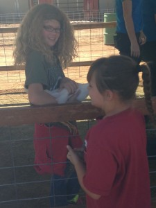 A fourth grader holds a chicken during a Farm Field Day field trip to Staheli Farm, Washington, Utah, Oct. 8, 2014 | Photo by Holly Coombs, St. George News